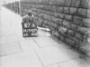 SD940917A, Man marking Ordnance Survey minor control revision point with an arrow in 1950s