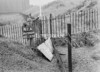 SD940941A, Man marking Ordnance Survey minor control revision point with an arrow in 1950s