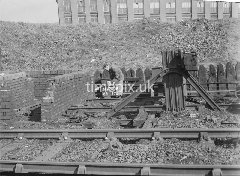 SD940913A, Man marking Ordnance Survey minor control revision point with an arrow in 1950s