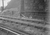 SD940917L, Man marking Ordnance Survey minor control revision point with an arrow in 1950s