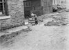 SD940944A, Man marking Ordnance Survey minor control revision point with an arrow in 1950s