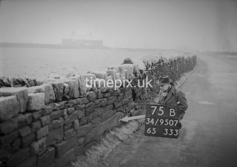 SD950775B, Man marking Ordnance Survey minor control revision point with an arrow in 1950s