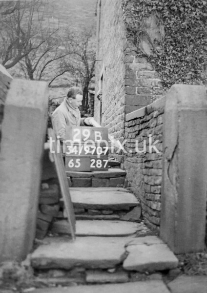 SD970729B, Man marking Ordnance Survey minor control revision point with an arrow in 1950s