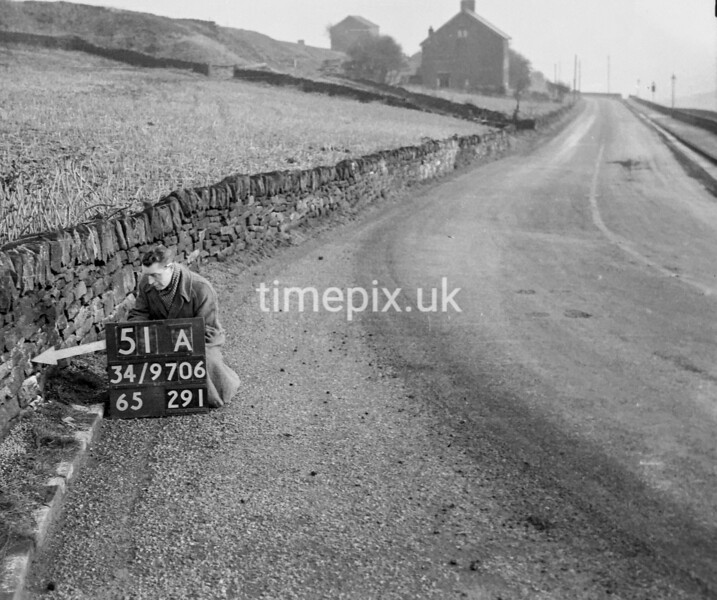 SD970651A, Man marking Ordnance Survey minor control revision point with an arrow in 1950s