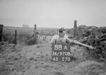 SD970888A, Man marking Ordnance Survey minor control revision point with an arrow in 1950s
