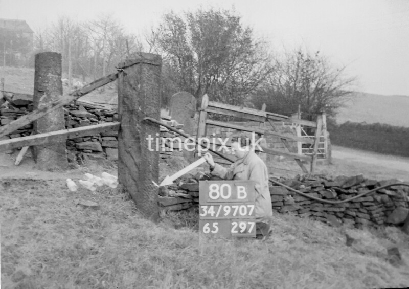 SD970780B, Man marking Ordnance Survey minor control revision point with an arrow in 1950s