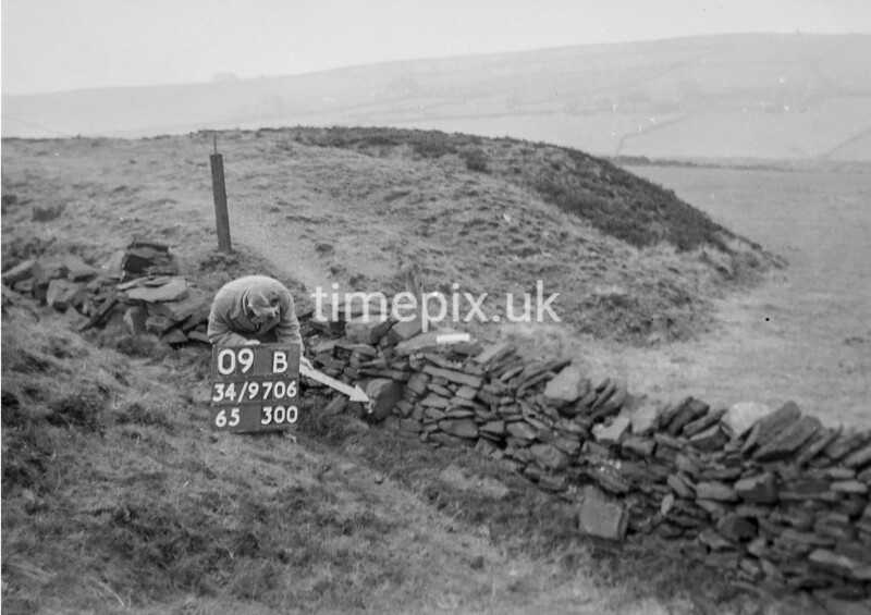 SD970609B, Man marking Ordnance Survey minor control revision point with an arrow in 1950s