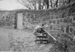 SD950504A, Man marking Ordnance Survey minor control revision point with an arrow in 1950s