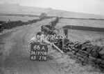 SD970866A, Man marking Ordnance Survey minor control revision point with an arrow in 1950s