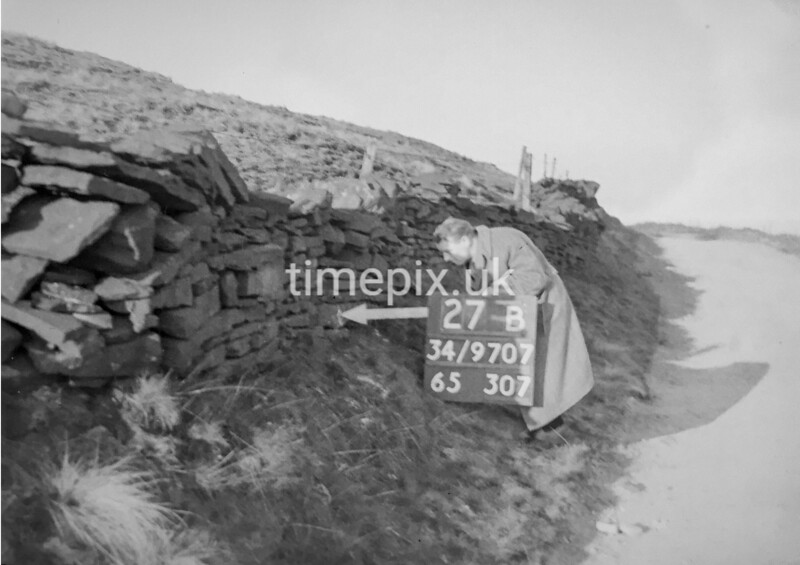 SD970727B, Man marking Ordnance Survey minor control revision point with an arrow in 1950s