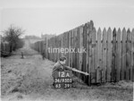 SD950512A, Man marking Ordnance Survey minor control revision point with an arrow in 1950s