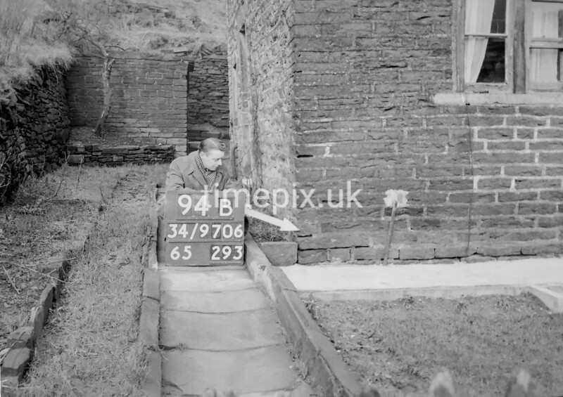 SD970694B, Man marking Ordnance Survey minor control revision point with an arrow in 1950s