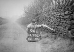 SD970794L, Man marking Ordnance Survey minor control revision point with an arrow in 1950s