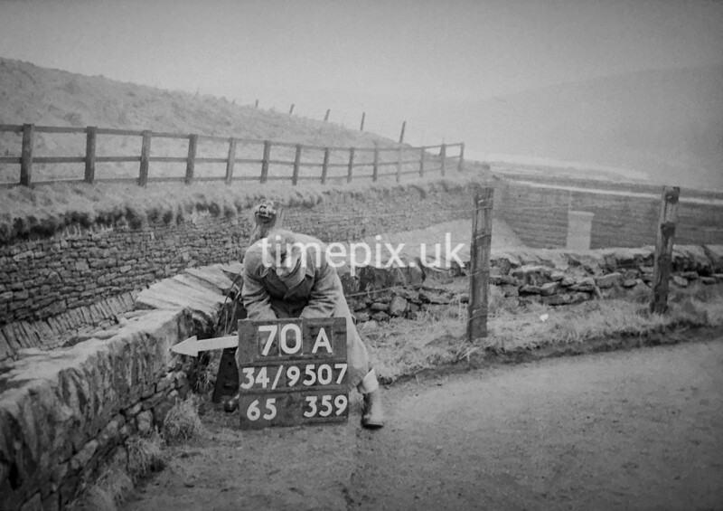 SD950770A, Man marking Ordnance Survey minor control revision point with an arrow in 1950s