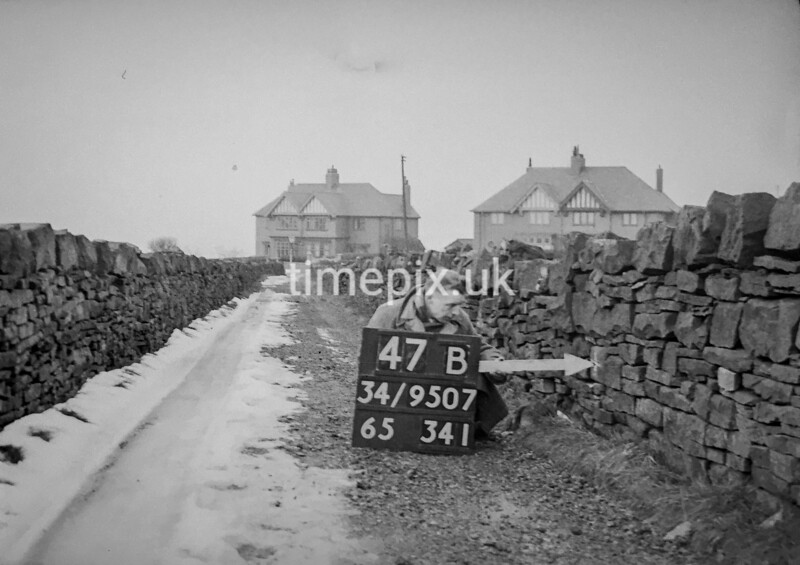 SD950747B, Man marking Ordnance Survey minor control revision point with an arrow in 1950s