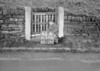 SD970682B, Man marking Ordnance Survey minor control revision point with an arrow in 1950s