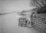SD970844A, Man marking Ordnance Survey minor control revision point with an arrow in 1950s