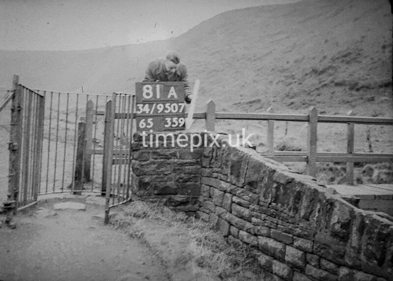 SD950781A, Man marking Ordnance Survey minor control revision point with an arrow in 1950s