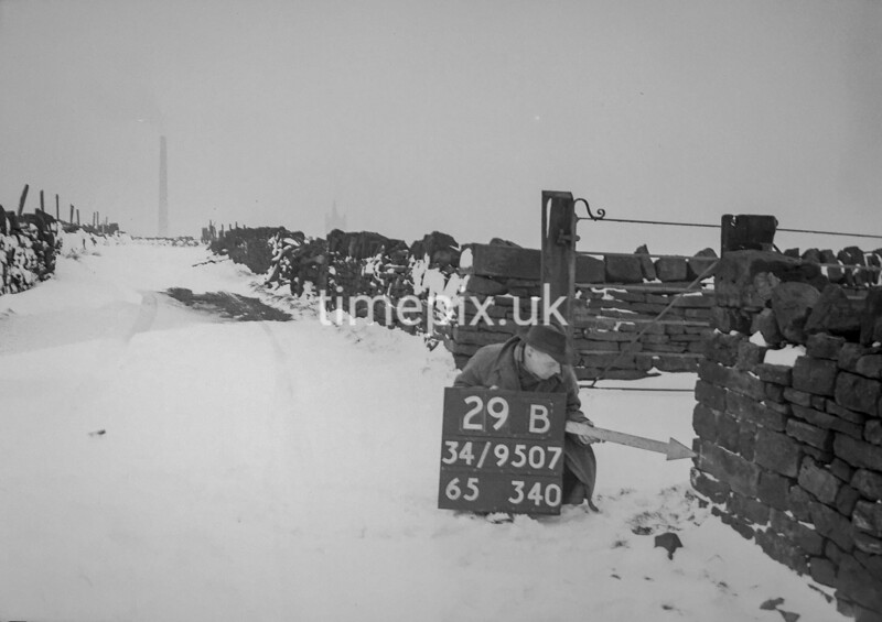 SD950729B, Man marking Ordnance Survey minor control revision point with an arrow in 1950s