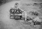 SD970897A, Man marking Ordnance Survey minor control revision point with an arrow in 1950s