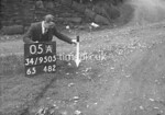SD950505A, Man marking Ordnance Survey minor control revision point with an arrow in 1950s