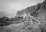 SD970870A, Man marking Ordnance Survey minor control revision point with an arrow in 1950s