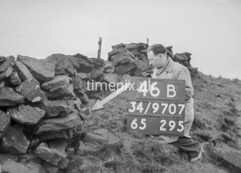 SD970746B, Man marking Ordnance Survey minor control revision point with an arrow in 1950s