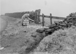 SD970665A, Man marking Ordnance Survey minor control revision point with an arrow in 1950s