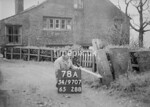 SD970778A2, Man marking Ordnance Survey minor control revision point with an arrow in 1950s