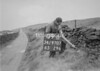 SD970709B, Man marking Ordnance Survey minor control revision point with an arrow in 1950s