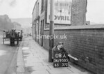 SD950508A, Man marking Ordnance Survey minor control revision point with an arrow in 1950s