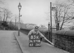 SD970883K, Man marking Ordnance Survey minor control revision point with an arrow in 1950s