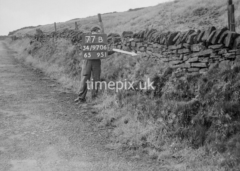 SD970677B, Man marking Ordnance Survey minor control revision point with an arrow in 1950s