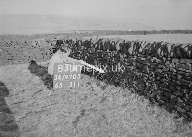 SD970583A, Man marking Ordnance Survey minor control revision point with an arrow in 1950s