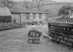 SD970770A, Man marking Ordnance Survey minor control revision point with an arrow in 1950s