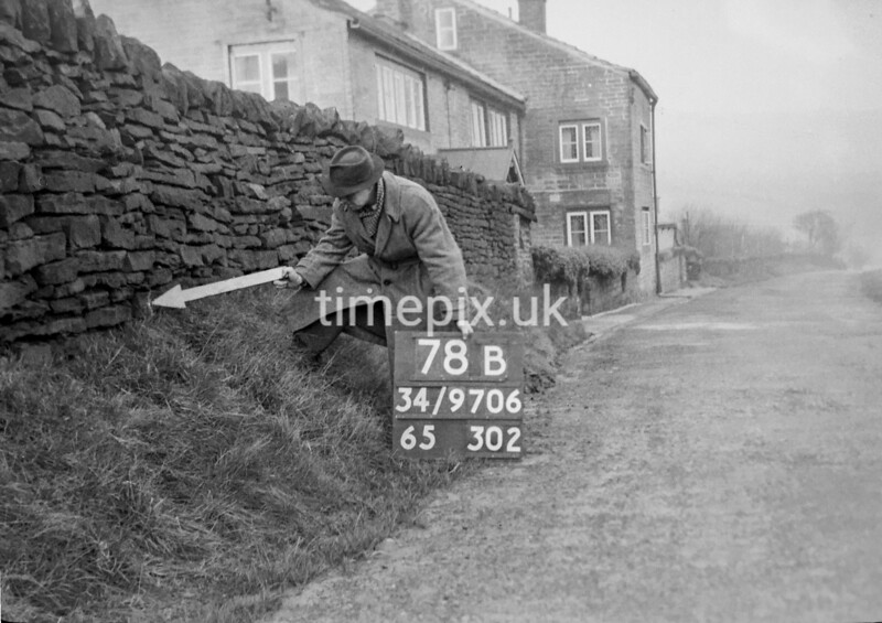 SD970678B, Man marking Ordnance Survey minor control revision point with an arrow in 1950s