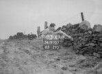 SD970713A, Man marking Ordnance Survey minor control revision point with an arrow in 1950s
