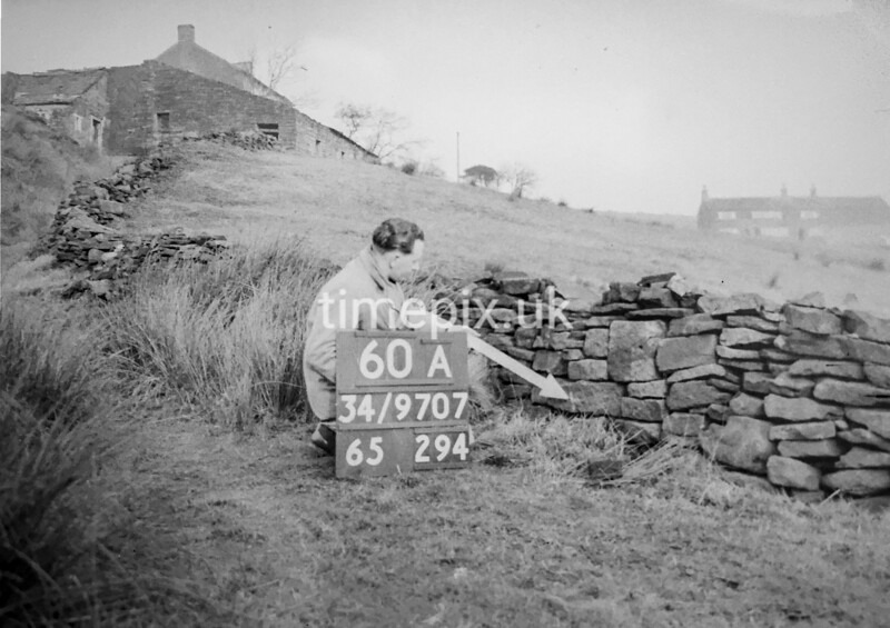 SD970760A, Man marking Ordnance Survey minor control revision point with an arrow in 1950s