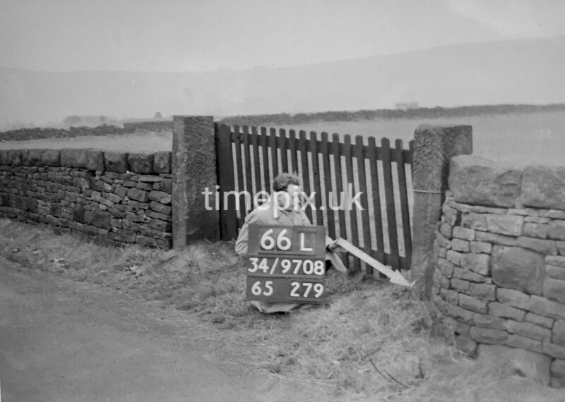 SD970866L, Man marking Ordnance Survey minor control revision point with an arrow in 1950s