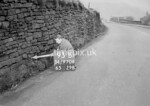 SD970693B, Man marking Ordnance Survey minor control revision point with an arrow in 1950s