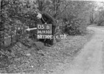 SD950505B, Man marking Ordnance Survey minor control revision point with an arrow in 1950s
