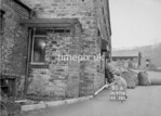 SD970891A, Man marking Ordnance Survey minor control revision point with an arrow in 1950s
