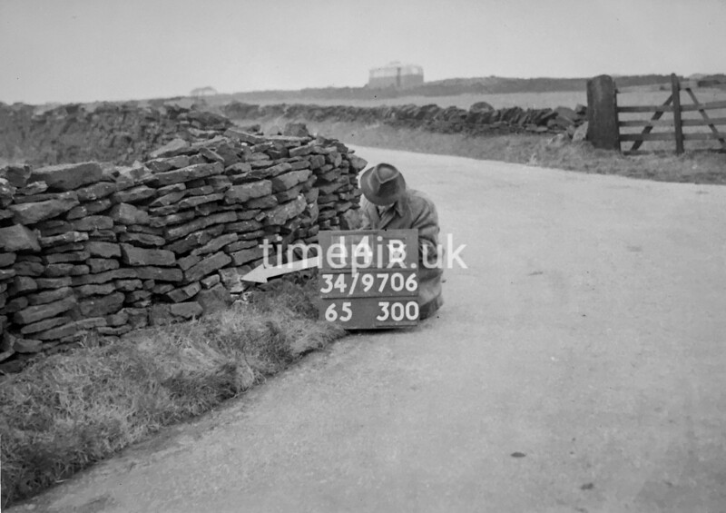 SD970614B, Man marking Ordnance Survey minor control revision point with an arrow in 1950s