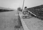 SD970777A, Man marking Ordnance Survey minor control revision point with an arrow in 1950s