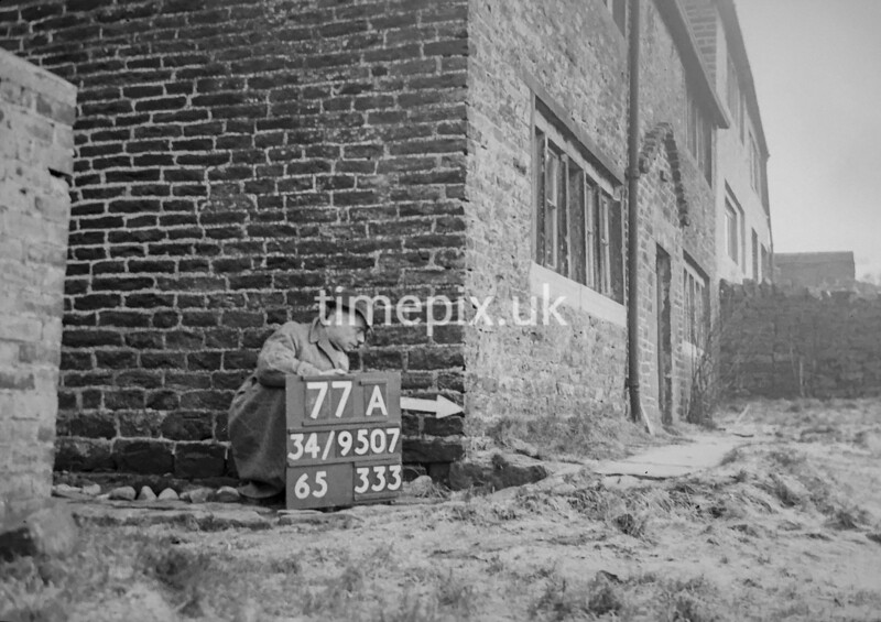 SD950777A, Man marking Ordnance Survey minor control revision point with an arrow in 1950s