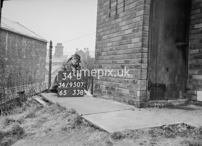 SD950734B, Man marking Ordnance Survey minor control revision point with an arrow in 1950s