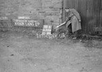 SD970698B, Man marking Ordnance Survey minor control revision point with an arrow in 1950s