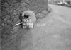 SD970693S, Man marking Ordnance Survey minor control revision point with an arrow in 1950s