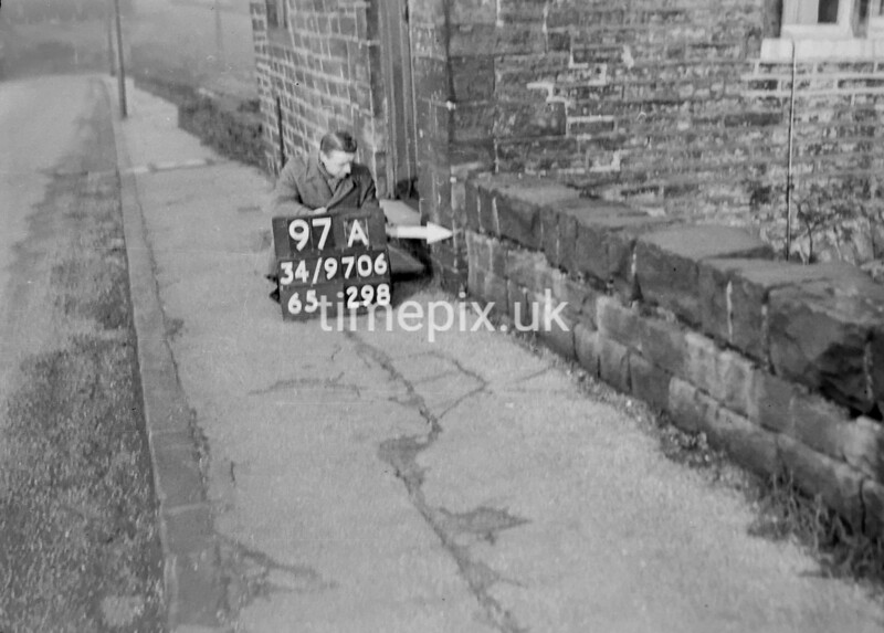 SD970697A, Man marking Ordnance Survey minor control revision point with an arrow in 1950s