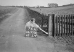 SD970874A, Man marking Ordnance Survey minor control revision point with an arrow in 1950s